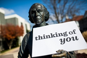 "Statue of James Madison holding a card that reads ""thinking of you"""